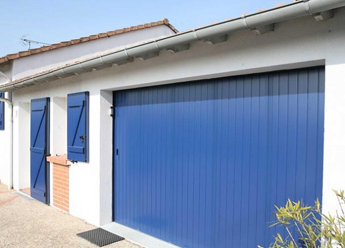 Porte de garage sectionnelle latérale 0